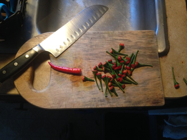 Ground Thai Peppers on Cutting Board