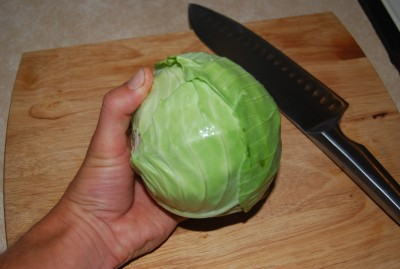 a cabbage in hand